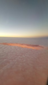 We left at 6:00 a.m. and this was the sun rising through the clouds as we fly home.